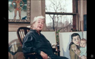 Alice Neel in front of paintings